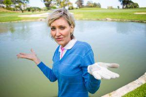 PuttBANDIT | Visibly Better Putting | Golfer shrugging her shoulders by a lake