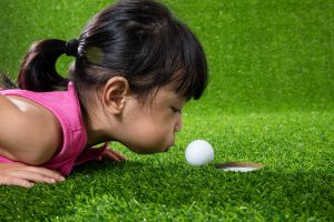 PuttBANDIT | Visibly Better Putting | Little girl blowing the ball into the hole