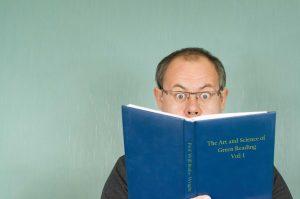 PuttBANDIT | Visibly Better Putting | Man reading a book