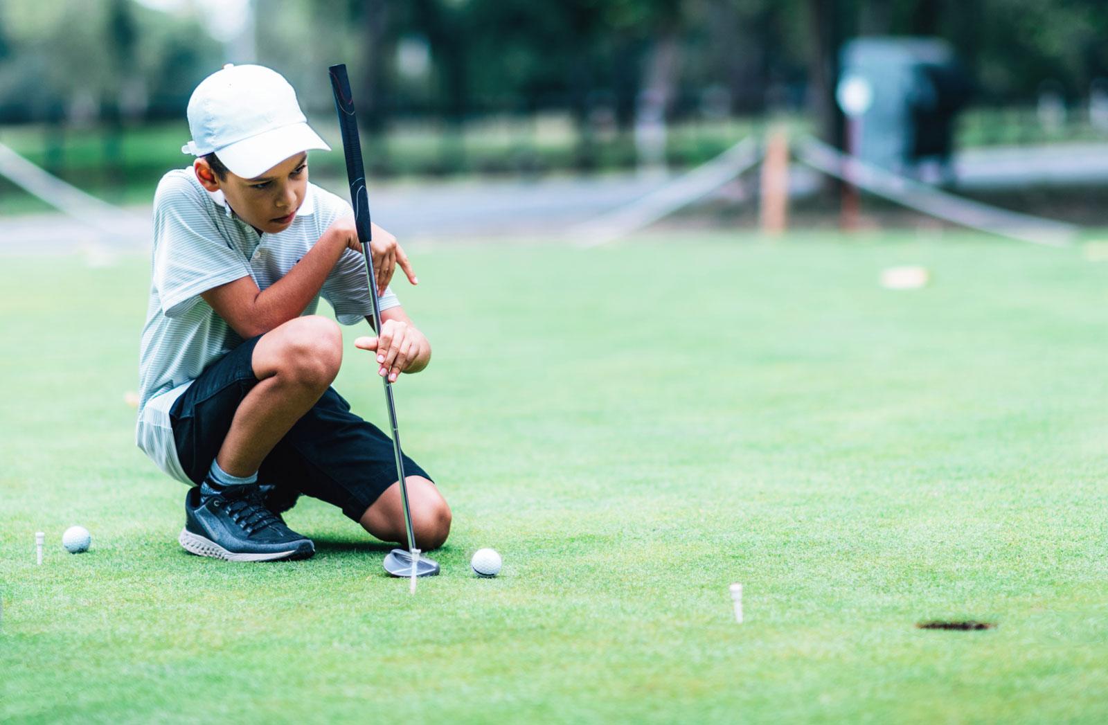 PuttBANDIT   Visibly Better Putting   Boy golfer